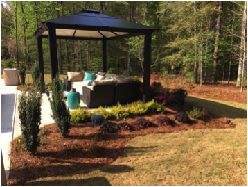 Landscaping surrounding a pergola